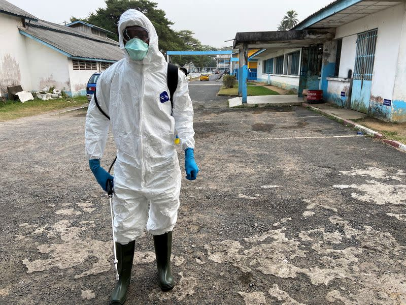 A medical staff wears protective gear at a new section specialised in receiving any person who may have been infected with coronavirus at The Quinquinie Hospital in Douala