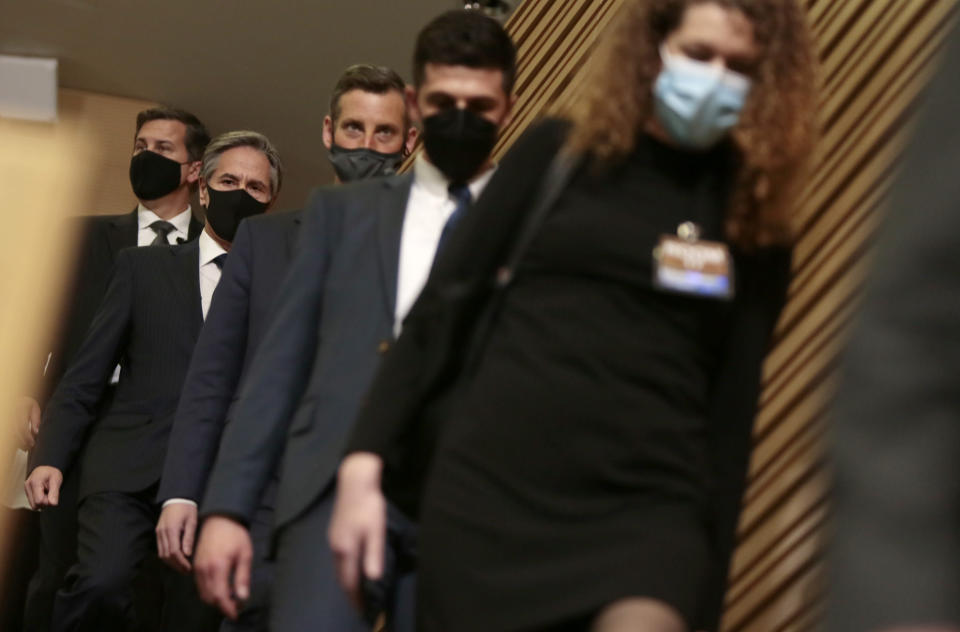 U.S. Secretary of State Antony Blinken, second left, arrives for a media conference after a meeting of NATO foreign ministers at NATO headquarters in Brussels on Wednesday, March 24, 2021. (AP Photo/Virginia Mayo, Pool)