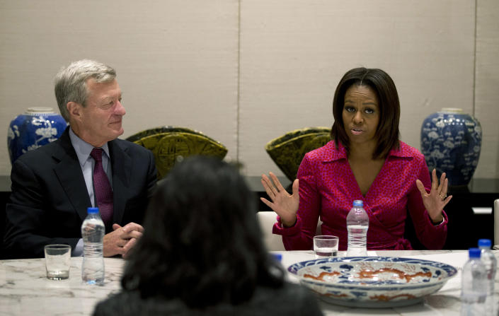 U.S. first lady Michelle Obama, right, speaks next to U.S. Ambassador to China Max Baucus as they attend a round table discussion on education at the U.S. Embassy in Beijing, China Sunday, March 23, 2014. (AP Photo/Andy Wong)