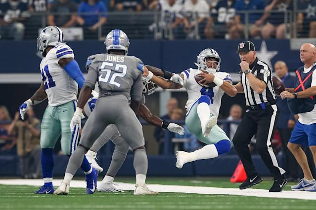 <p>Dallas Cowboys quarterback Dak Prescott (4) is hit while running with the ball during the game between the Detroit Lions and Dallas Cowboys on September 30, 2018 at AT&T Stadium in Arlington, TX. (Photo by Andrew Dieb/Icon Sportswire via Getty Images) </p>