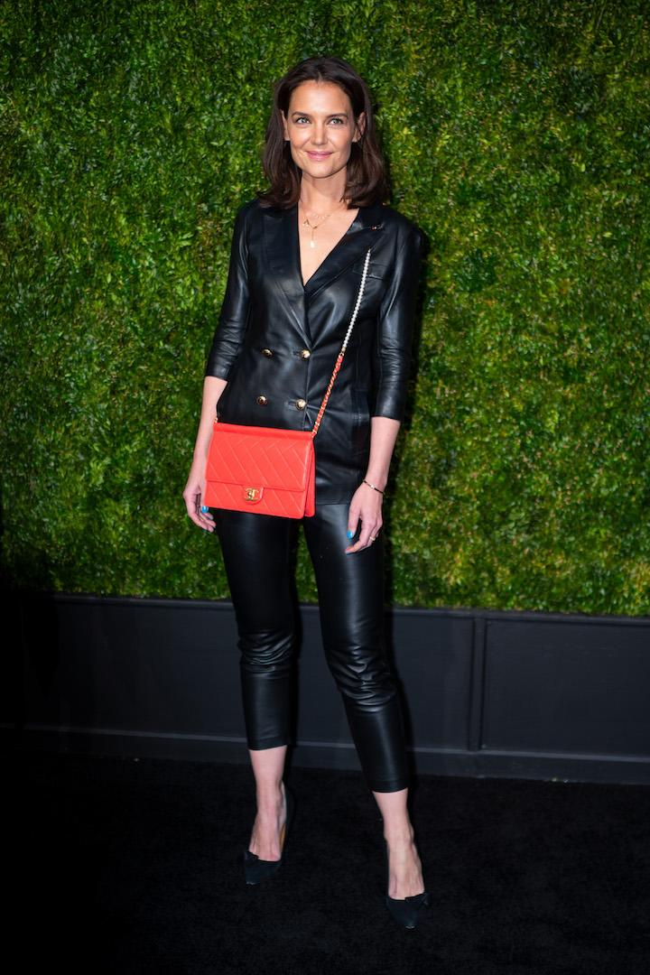 At the 2019 Tribeca Film Festival Artists Dinner, Katie Holmes stepped away from her sartorial comfort zone in a leather suit courtesy of Zeynep Arcay. A colour popping Chanel cross-body bag gave the all-black ensemble a punchy finish. <em>[Photo: Getty]</em>