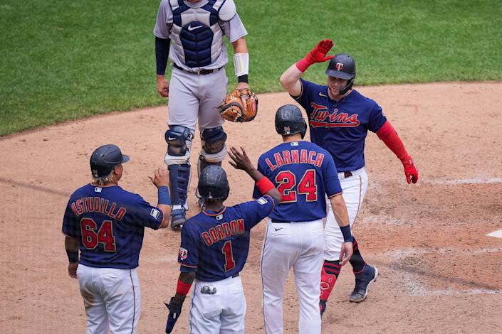Minnesota Twins catcher Ryan Jeffers (27) celebrates his grand slam with his team July 28, 2021 against the Detroit Tigers in the fourth inning at Target Field in Minneapolis.