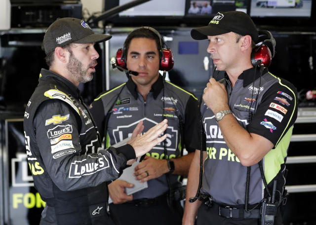 Jimmie Johnson (L) and Chad Knaus (R) have won seven Cup Series titles together. (AP Photo/John Raoux)