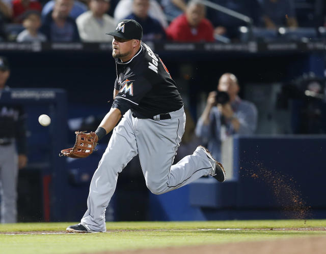 Miami Marlins third baseman Casey McGehee (9) fields a ball hit for a single by Atlanta Braves shortstop Andrelton Simmons (19) in the eighth inning of a baseball game Tuesday, April 22, 2014 in Atlanta. (AP Photo/John Bazemore)
