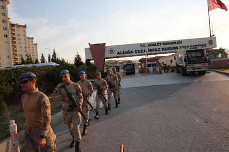 Soldiers walk in front of the Aliaga Prison and Courthouse complex in Izmir, Turkey October 12, 2018. REUTERS/Umit Bektas