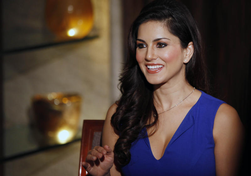 """In this Sunday, July 29, 2012 photo, hard-core porn actress Sunny Leone, who stars in Bollywood film """"Jism 2"""" speaks to the media in Mumbai, India. The film, which will be released across India on Friday, is pushing the ever-widening sexual boundaries enjoyed by many in urban India. (AP Photo/Rajanish Kakade)"""