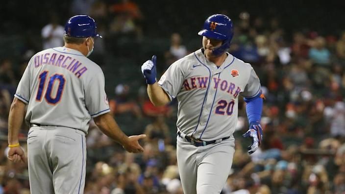 New York Mets' Pete Alonso (20) is congratulated by third base coach Gary Disarcina (10) after hitting a two-run home run against the Arizona Diamondbacks during the seventh inning at Chase Field May 31, 2021. Mets Vs Diamondbacks