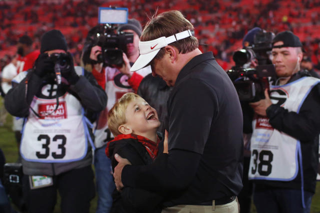 Georgia coach Kirby Smart celebrates with one of his sons after the team's NCAA college football game against Missouri on Saturday, Nov. 9, 2019, in Athens, Ga. (Joshua L. Jones/Athens Banner-Herald via AP)