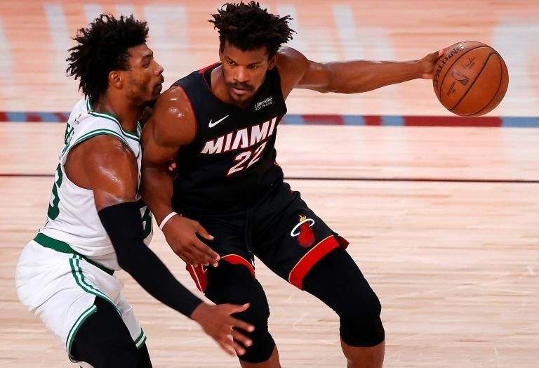 Jimmy Butler (right) has played a pivotal role in Miami's run to the NBA Finals