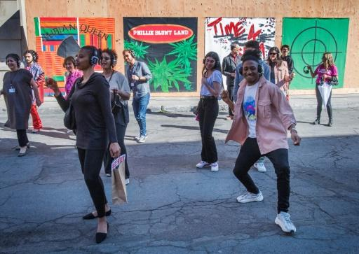 The dance work sees visitors don headphones and join a choreographed line dance