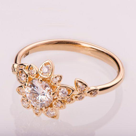 """<i><a href=""""https://www.etsy.com/listing/214908560/moissanite-art-deco-petal-engagement?ga_search_query=moissanite&ref=shop_items_search_37"""" target=""""_blank"""">Buy it fromDoronMerav on Etsy</a> for$1,200+.</i>"""