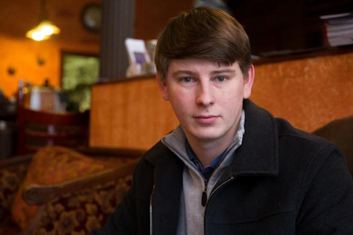 """Bart Murawski, 27 poses at a coffee shop Tuesday, Nov. 26, 2013, in Troy, N.Y. You can take our word for it: Americans don't trust each other anymore. An AP-GfK poll conducted last month found that Americans are suspicious of each other in everyday encounters. Less than a third expressed a lot of trust in clerks who swipe their credit cards, drivers on the road, or people they meet when traveling. """"I'm leery of everybody,"""" said Murawski. """"Caution is always a factor."""" (AP Photo/Shannon DeCelle)"""