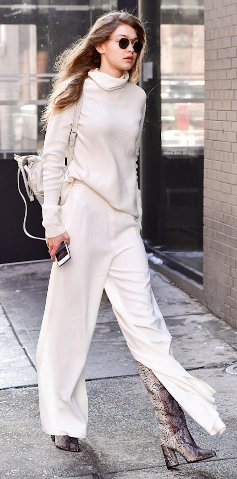 "<p>Hadid stepped out in chilly N.Y.C. less than 48 hours after a snowstorm in loose white pants and heeled boots, proving that she truly is a style wizard. She paired the look with a ivory cashmere turtleneck Stephanie Rad sweater ($950; preorder on <a rel=""nofollow"" href=""http://www.stephanierad.com/new-products/"">stephanierad.com</a>) and a matching bag, making winter whites look oh-so-chic.</p>"