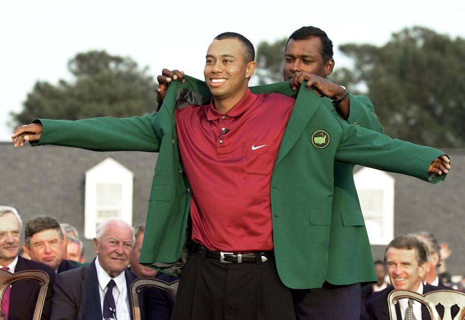 <p>Tiger Woods, left, receives his Masters green jacket from last year's champion Vijay Singh, of Fiji, at a ceremony after winning the 2001 Masters at the Augusta National Golf Club in Augusta, Ga., Sunday, April 8, 2001. Woods captured this second Masters title, defeating David Duval by two strokes. (AP Photo/Amy Sancetta) </p>