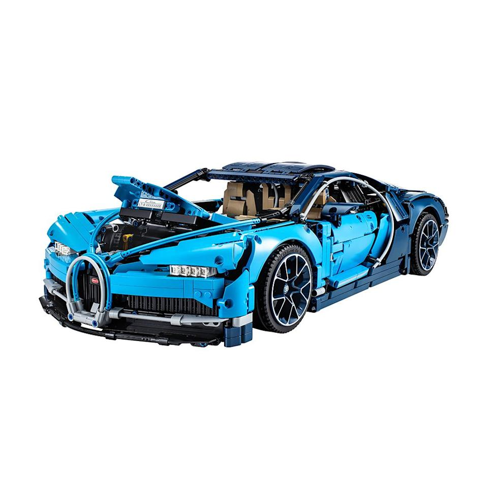 "<p><strong>LEGO</strong></p><p>amazon.com</p><p><strong>$349.95</strong></p><p><a href=""http://www.amazon.com/dp/B07C8L9CRJ/"" target=""_blank"">Shop Now</a></p><p>The Bugatti Chiron car building kit by Lego Technic is handily one of the coolest gifts to give an automotive enthusiast in your life. </p><p>A product of close collaboration between LEGO and Bugatti, the kit has a whopping 3,599 parts, a unique serial number, and elaborate detailing throughout. The 1:8 scale car is also impossible to miss when finished. </p><p>We really love that LEGO's instructions for the kit mirror the assembly process of a Bugatti Chiron. Best of all, just like the real Chiron, the LEGO version comes with its own high-speed key!</p>"