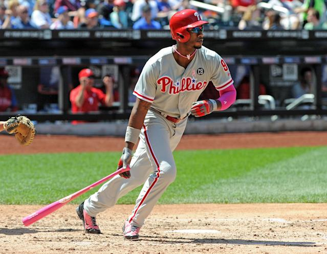 NEW YORK, NY - MAY 11: Domonic Brown #9 of the Philadelphia Phillies watches his RBI single during the top of the fourth inning against the New York Mets on May 11, 2014 at Citi Field in the Flushing neighborhood of the Queens borough of New York City. (Photo by Christopher Pasatieri/Getty Images)