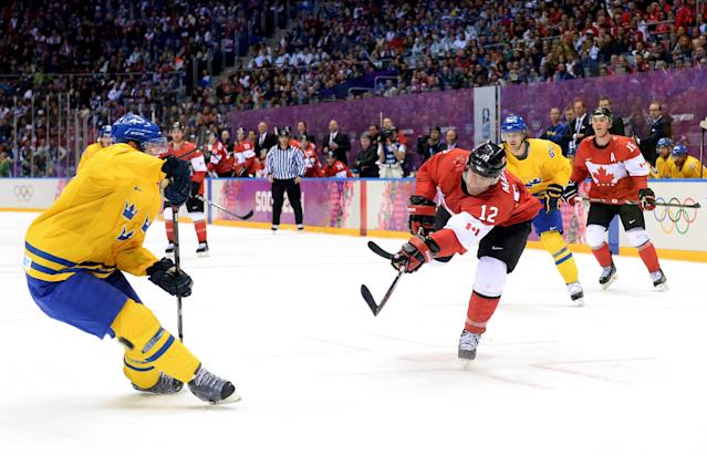 SOCHI, RUSSIA - FEBRUARY 23: Jonathan Toews #16 of Canada shoots against Niklas Kronwall #55 of Sweden during the Men's Ice Hockey Gold Medal match on Day 16 of the 2014 Sochi Winter Olympics at Bolshoy Ice Dome on February 23, 2014 in Sochi, Russia. (Photo by Harry How/Getty Images)