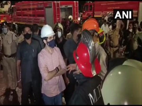 Aaditya Thackeray along with other officials was seen conversing with the fire department personnel at Nagpada. Photo/ANI