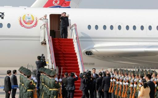 North Korea's official name and flag appear on the ageing Soviet-made aircraft