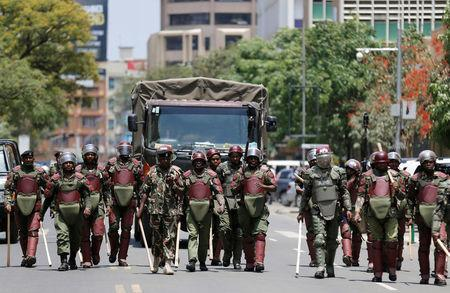 Riot policemen walk along a street in an attempt to disperse supporters of Kenyan opposition National Super Alliance (NASA) coalition, during a protest along a street in Nairobi, Kenya October 16, 2017. REUTERS/Thomas Mukoya