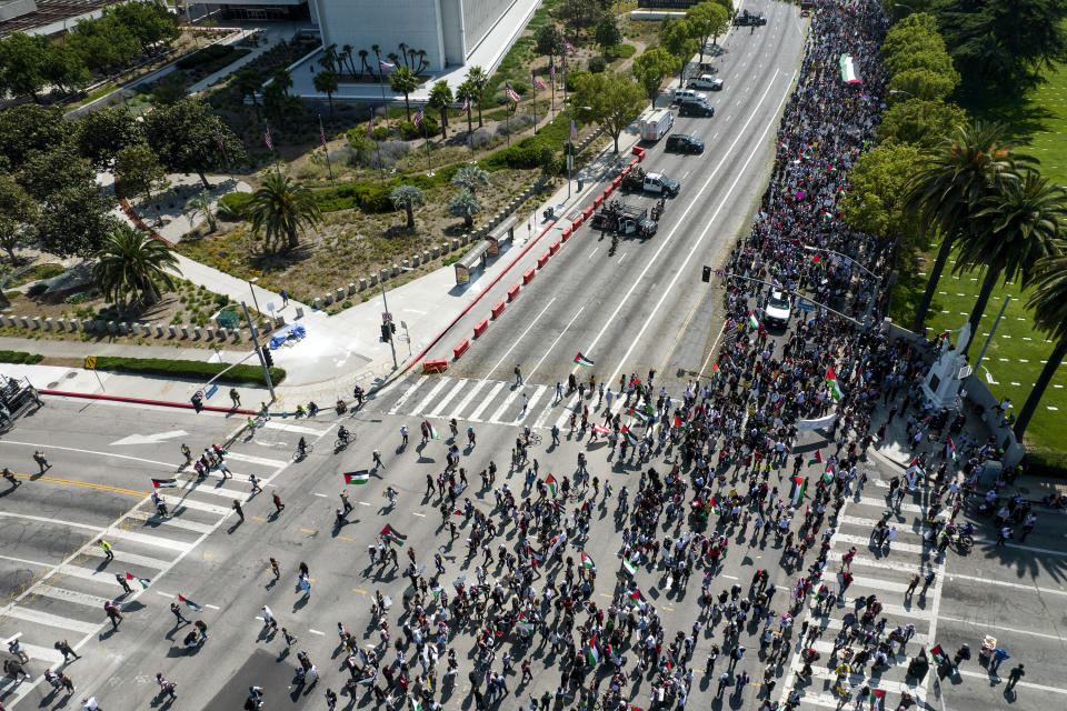 In this photo taken by a drone, thousands of demonstrators protest outside the Federal Building against Israel and in support of Palestinians, Saturday, May 15, 2021 in the Westwood section of Los Angeles. (AP Photo/Ringo H.W. Chiu)