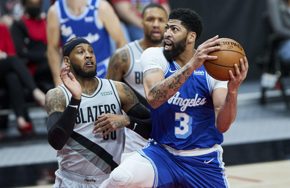 Los Angeles Lakers forward Anthony Davis, right, shoots over Portland Trail Blazers forward Carmelo Anthony during the first half of an NBA basketball game in Portland, Ore., Friday, May 7, 2021. (AP Photo/Craig Mitchelldyer)