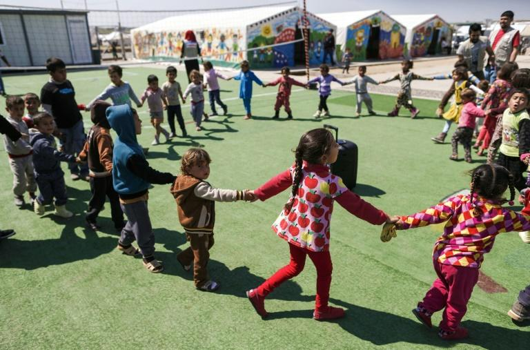 With the impetuousness that only the young can muster, displaced children at Hasan Sham camp forget for a moment the hell they've been through in Mosul