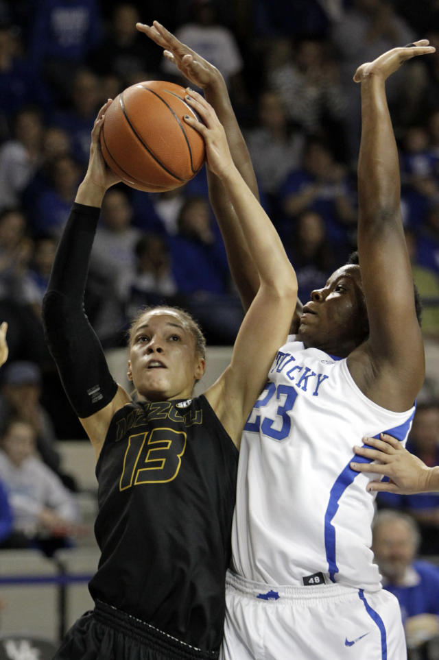 Missouri's Bri Kulas (13) shoots under pressure from Kentucky's Samarie Walker (23) during the first half of an NCAA college basketball game, Sunday, Jan. 12, 2014, in Lexington, Ky. (AP Photo/James Crisp)