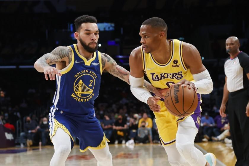 Los Angeles Lakers guard Russell Westbrook (0) drives against Golden State Warriors forward Chris Chiozza (2) during the first half of a preseason NBA basketball game in Los Angeles, Tuesday, Oct. 12, 2021. (AP Photo/Ringo H.W. Chiu)