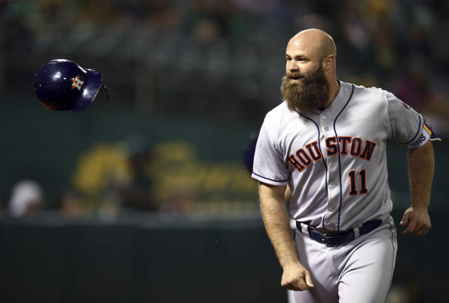 Houston Astros' Evan Gattis flips his helmet after hitting a home run off Oakland Athletics' Danny Coulombe during the seventh inning of a baseball game Wednesday, June 13, 2018, in Oakland, Calif. (AP Photo/Ben Margot)