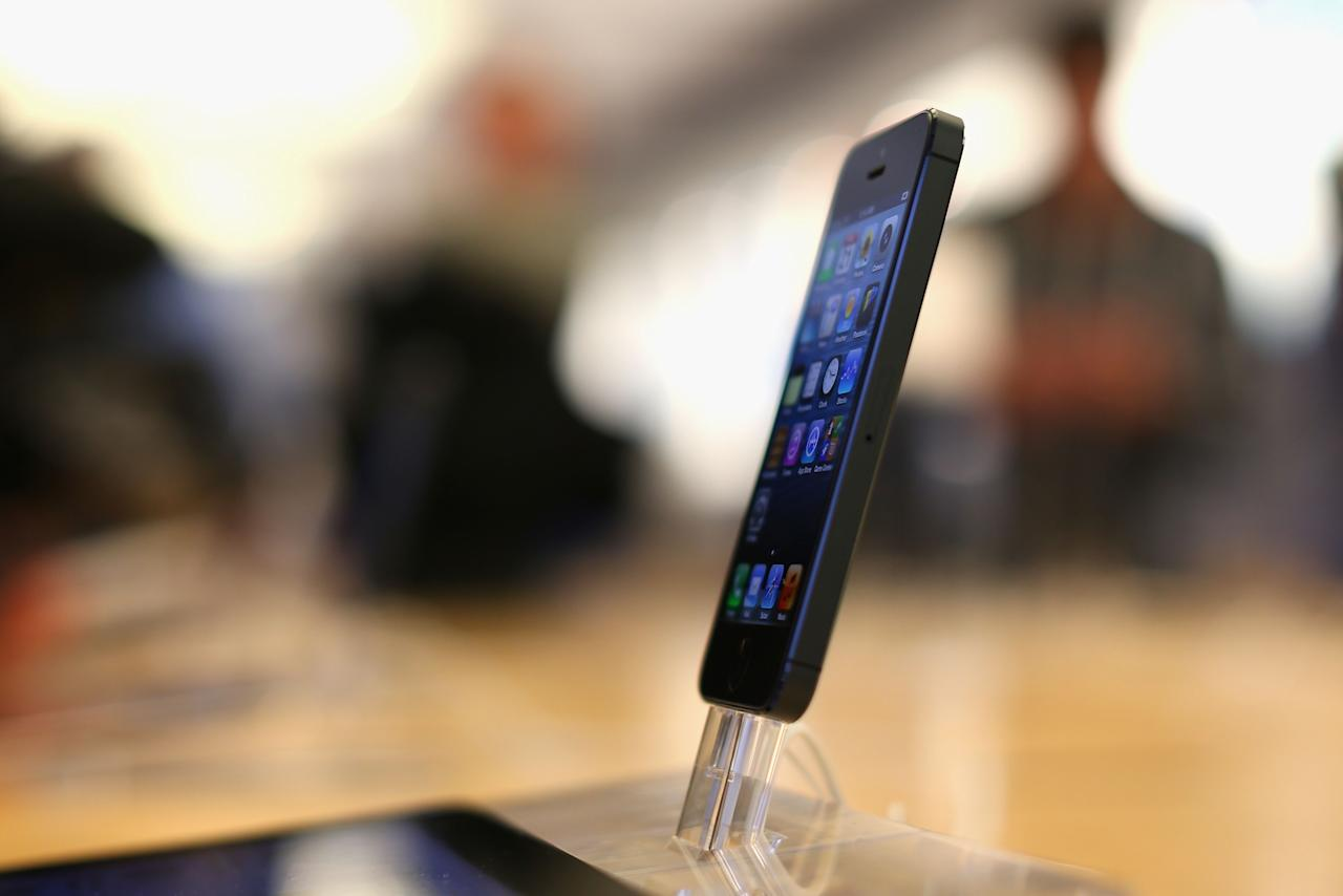 SYDNEY, AUSTRALIA - SEPTEMBER 21:  The iPhone 5 smartphone is displayed at the Apple flagship store on George street on September 21, 2012 in Sydney, Australia. Australian Apple stores are the first in the world to receive and sell the new iPhone 5 handsets.  (Photo by Cameron Spencer/Getty Images)