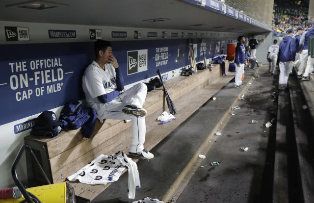 Seattle Mariners starting pitcher Felix Hernandez, left, sits in the dugout after he was pulled from the team's baseball game against the Texas Rangers during the sixth inning Tuesday, May 29, 2018, in Seattle. (AP Photo/Ted S. Warren)