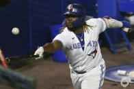 Toronto Blue Jays' Vladimir Guerrero Jr. tries to get to a foul ball with his bat during the eighth inning of a baseball game against the Baltimore Orioles in Buffalo, N.Y., Thursday, June 24, 2021. (AP Photo/Joshua Bessex)