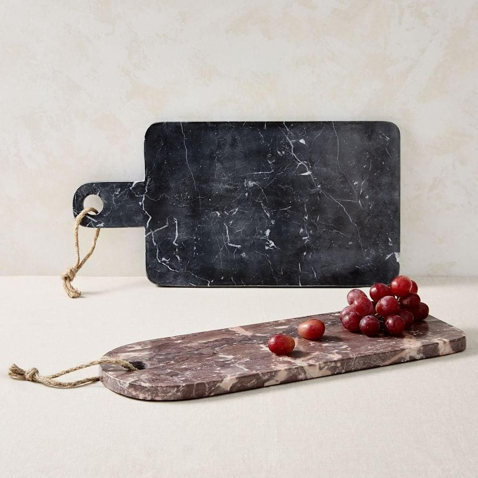 <p>These <span>New Shapes Marble Boards</span> ($50 each) look sleek and modern.</p>