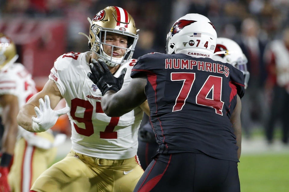 San Francisco 49ers defensive end Nick Bosa (97) blocks against Arizona Cardinals offensive tackle D.J. Humphries (74) during the second half of an NFL football game, Thursday, Oct. 31, 2019, in Glendale, Ariz. (AP Photo/Rick Scuteri)