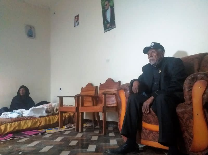 Hundeessaa Bonsa, father to the slain Ethiopian political singer Haacaaluu Hundeessaa talks during a Reuters interview, as the singer's mother Gudetu Hora looks on, at their home in Ambo