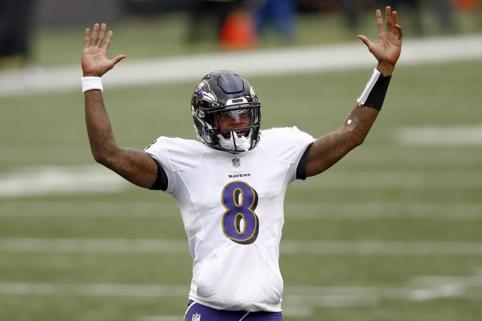 Baltimore Ravens quarterback Lamar Jackson (8) celebrates after running back J.K. Dobbins (27) ran in for a touchdown against the Cincinnati Bengals during the second half of an NFL football game, Sunday, Jan. 3, 2021, in Cincinnati. (AP Photo/Aaron Doster)