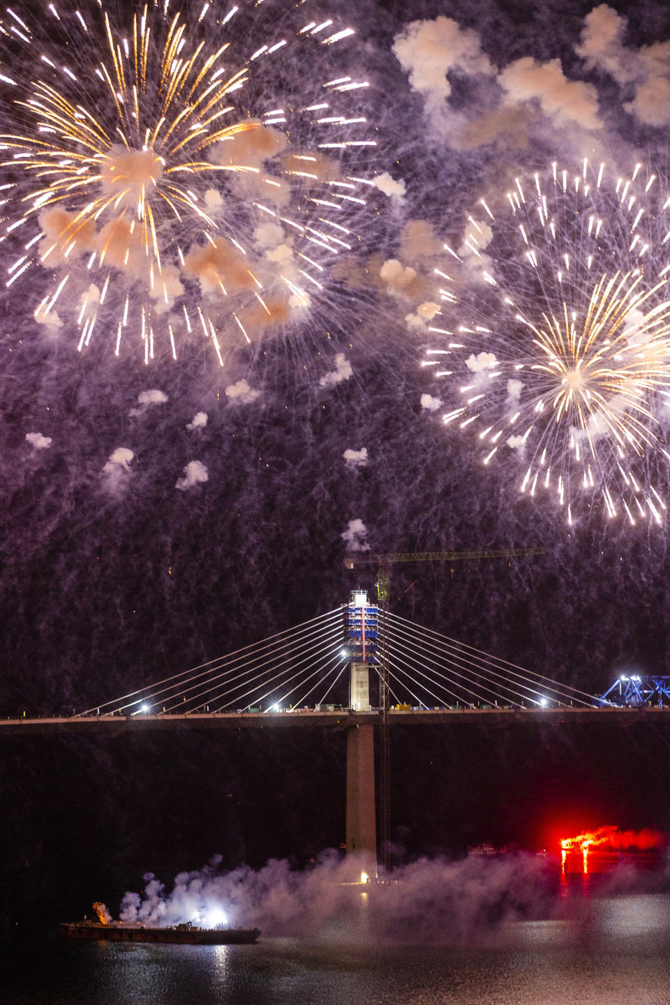 Fireworks light up the skies at the construction site of the Peljesac Bridge in Komarna, Croatia, Thursday, July 29, 2021. European Union-funded Peljesac Bridge in southern Croatia that has been built by a Chinese state-owned company was opened late Wednesday. The bridge was designed to connect two swaths of Adriatic Sea coastline and passes over a small stretch of Bosnia's territory. (AP Photo)