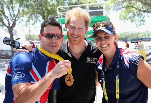 Jaco van Gass, left, celebrates with Invictus Games founder Prince Harry, centre, at the 2016 event
