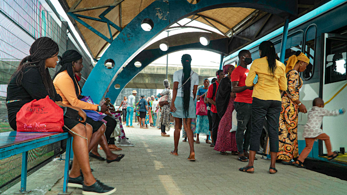 Commuters at a bus stop in Lagos,Nigeria