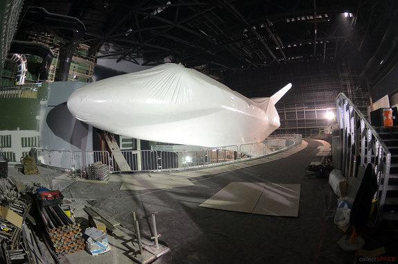 Shuttle Atlantis Under Wraps as Exhibit's Rocket Boosters Rise