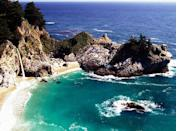 """<p>Possibly the most <a href=""""https://www.purewow.com/travel/best-california-road-trips"""" rel=""""nofollow noopener"""" target=""""_blank"""" data-ylk=""""slk:scenic stop"""" class=""""link rapid-noclick-resp"""">scenic stop</a> along Big Sur, the McWay Falls plunge 80 feet over a gorgeous sandy shore and into the Pacific Ocean.</p>"""