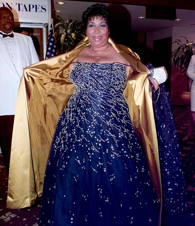 <p>The singer shows off her dress to photographers as she attends the 1999 White House Correspondents Association Dinner. (Rex) </p>
