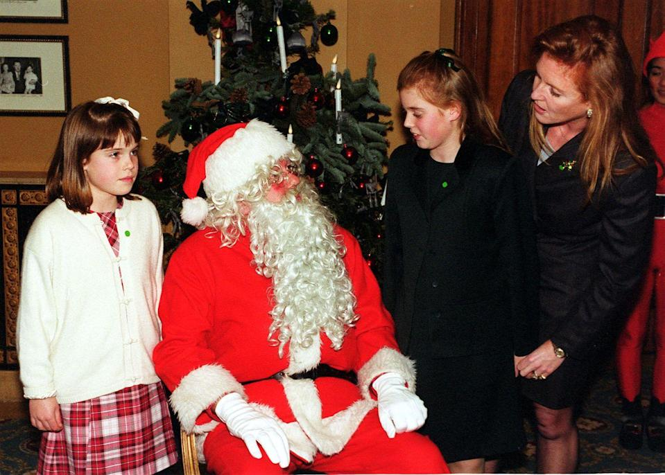 <p>The Duchess of York takes her daughters, Princess Eugenie and Princess Beatrice, to meet Santa at the National Society for the Prevention of Cruelty to Children party.</p>
