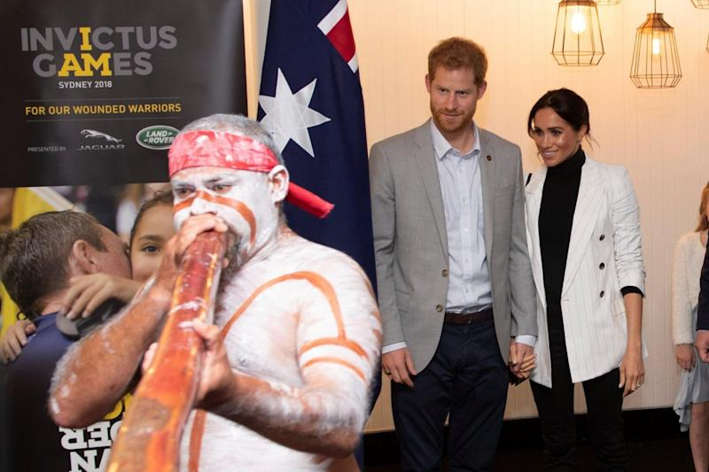 Harry and Meghan watch a performer at a lunchtime reception hosted by the Prime Minister (REUTERS)