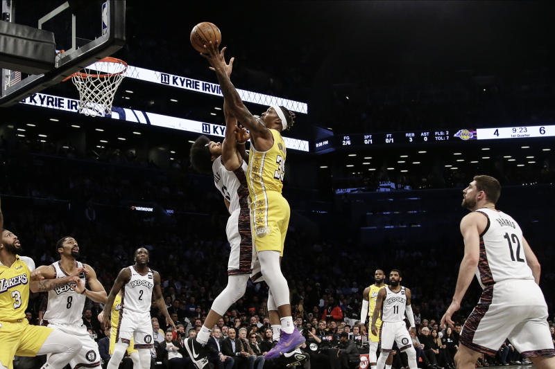 Los Angeles Lakers' Dwight Howard (39) shoots over Brooklyn Nets' Jarrett Allen (31) during the first half of an NBA basketball game Thursday, Jan. 23, 2020, in New York. (AP Photo/Frank Franklin II)