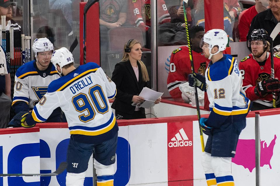 """<div class=""""caption""""> Coyne Schofield analyzing the game from the ice </div> <cite class=""""credit"""">Timothy Hiatt / NBC Sports</cite>"""