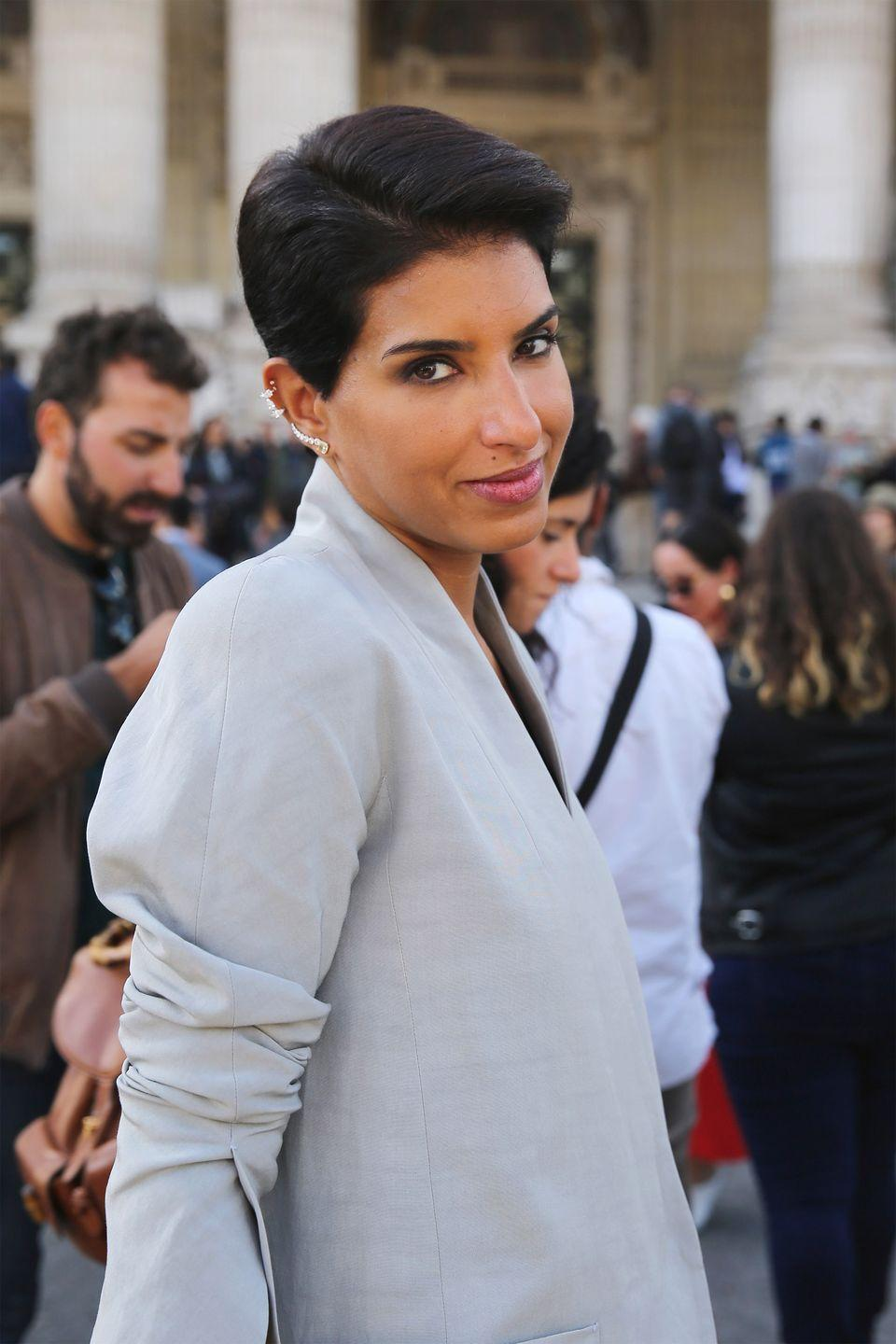 "<p>Born in California, the 42-year-old Saudi princess is a fashion week veteran and the co-founder and director of D'NA, an exclusive Saudi Arabian-based boutique that has made waves across the Middle East and beyond. In 2016, Abdulaziz was named the first-ever editor-in-chief of <em>Vogue Arabia</em>, which debuted its print edition in March 2017 with <a href=""https://www.buzzfeed.com/ikrd/assalamualaikum"" rel=""nofollow noopener"" target=""_blank"" data-ylk=""slk:Gigi Hadid wearing a hijab on the cover"" class=""link rapid-noclick-resp"">Gigi Hadid wearing a hijab on the cover</a>. One month later, with only two editions under her belt, Abdulaziz was fired from the publication. ""I refused to compromise when I felt the publisher's approach conflicted with the values which underpin our readers and the role of the editor-in-chief in meeting those values in a truly authentic way,"" she told <em><a href=""https://www.businessoffashion.com/articles/news-analysis/deena-aljuhani-abdulaziz-exits-vogue-arabia"" rel=""nofollow noopener"" target=""_blank"" data-ylk=""slk:BoF"" class=""link rapid-noclick-resp"">BoF</a></em>.</p>"
