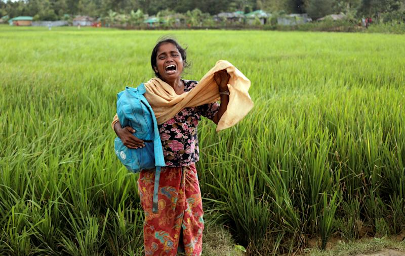 Taslima, a 20-year-old Rohingya refugee, cries on Oct. 16 after her father died while crossing the Myanmar-Bangladesh border. (Zohra Bensemra/Reuters)