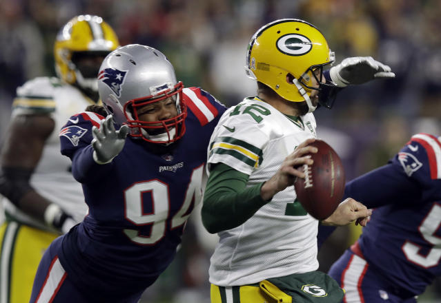 New England Patriots defensive end Adrian Clayborn (94) chases down Green Bay Packers quarterback Aaron Rodgers (12) during the second half of an NFL football game, Sunday, Nov. 4, 2018, in Foxborough, Mass. (AP Photo/Charles Krupa)